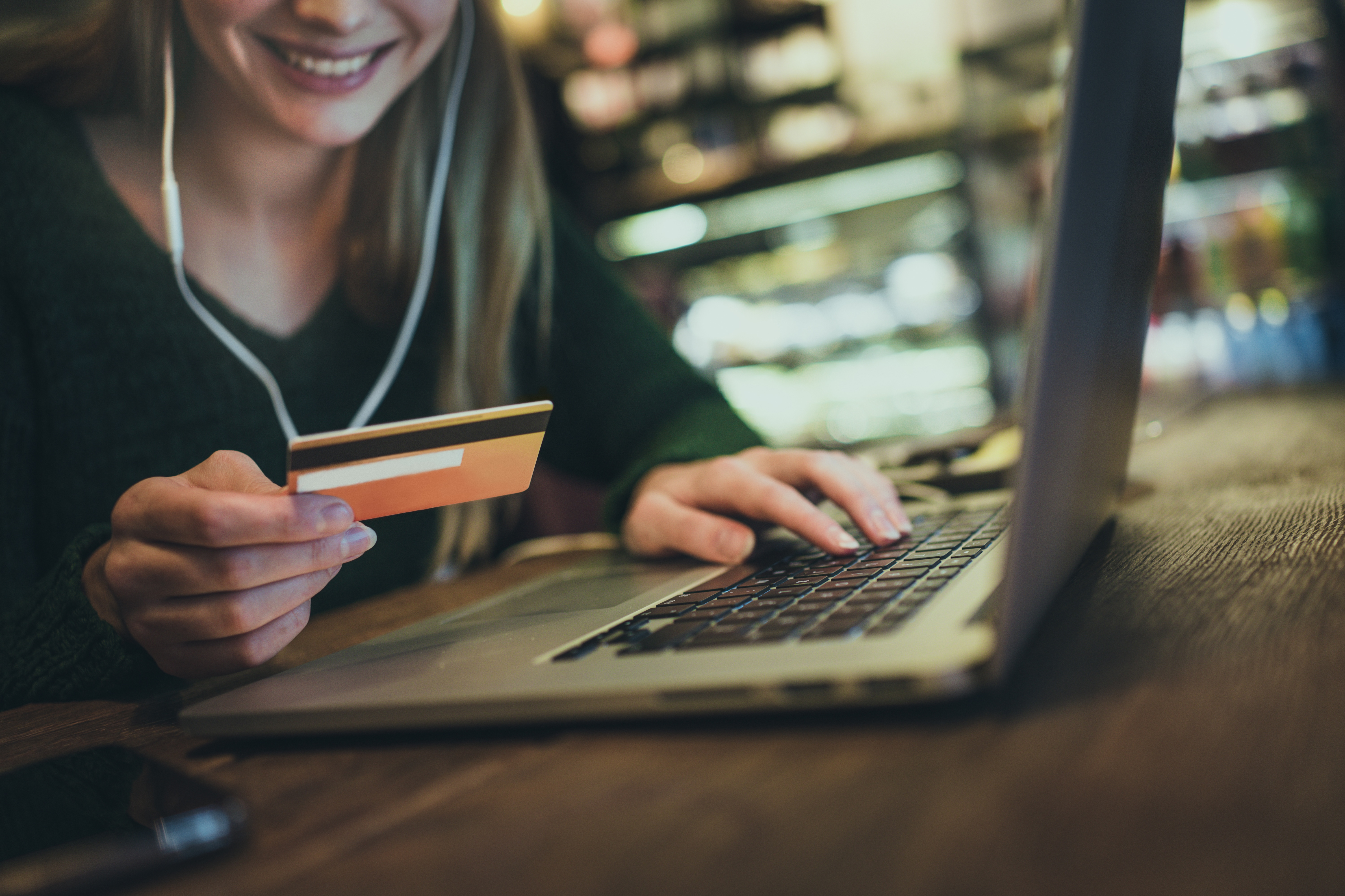 A person using a credit card to buy online